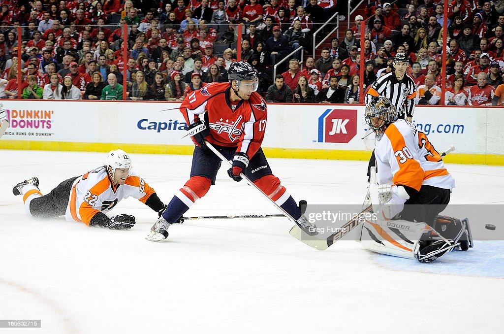 Wojtek Wolski #17 of the Washington Capitals scores in the third period against Ilya Bryzgalov #30 of the Philadelphia Flyers at the Verizon Center on February 1, 2013 in Washington, DC. Washington won the game 3-2.