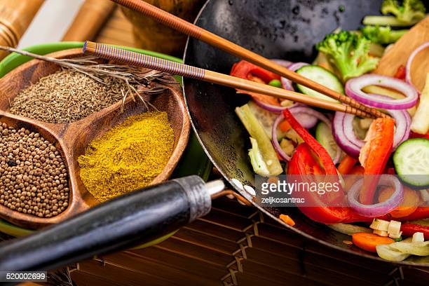 wok stir fry with vegetables and spices - curry powder stock photos and pictures