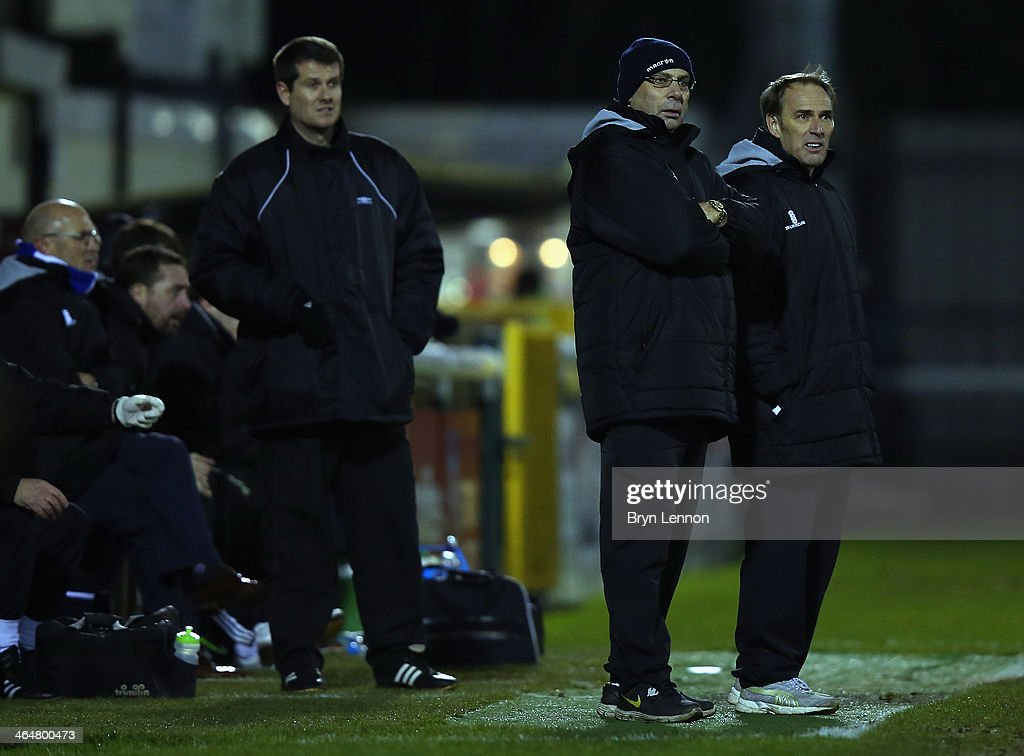 Woking FC Manager Garry Hill (c) looks on during the Skrill Conference Premier match between Woking and Chester at the Kingfield Stadium on January 21, 2014 in Woking, England.