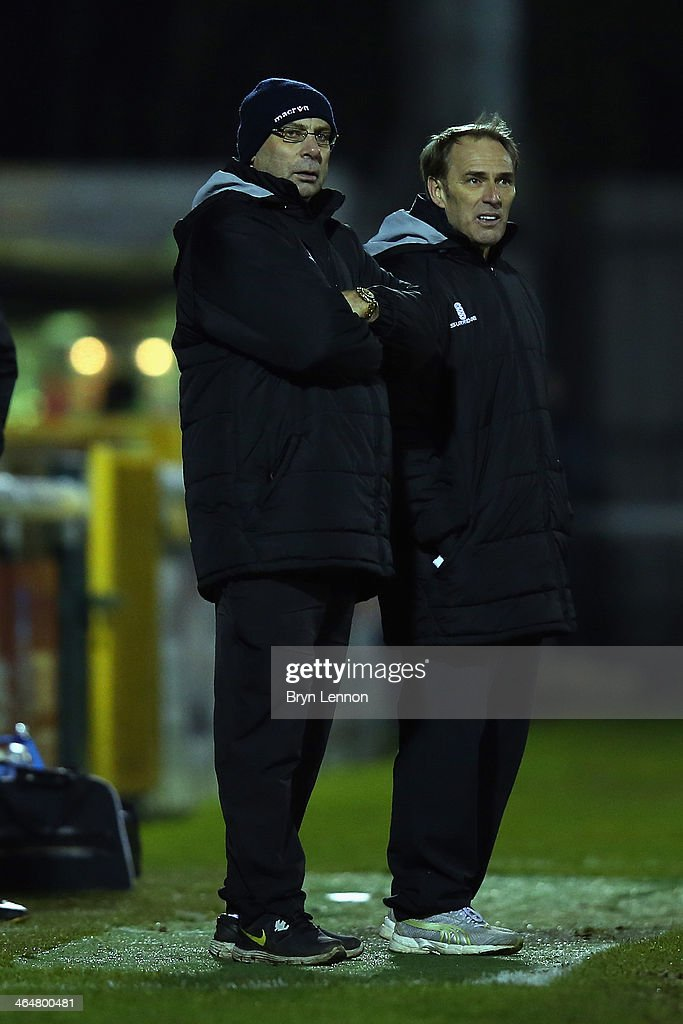 Woking FC Manager Garry Hill (l) looks on during the Skrill Conference Premier match between Woking and Chester at the Kingfield Stadium on January 21, 2014 in Woking, England.