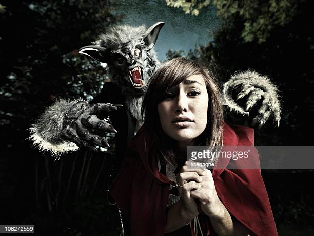 wolf and little red ridding hood - monster fictional character stock pictures, royalty-free photos & images