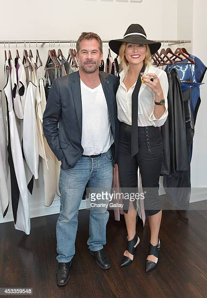 Wolf Worster and Holly Wolf attend Saudi Designer Nora Al Shaikh Unveils Her Coveted Eveningwear Collection At Decades LA at Decades on August 8 2014...