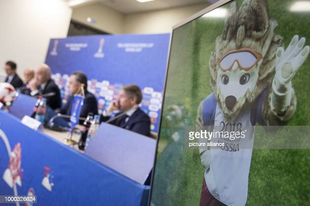 Wolf 'Zabivaka' the official mascot of the FIFA World Championship Russia 2018 can be seen on a screen during the final press conference of FIFA at...