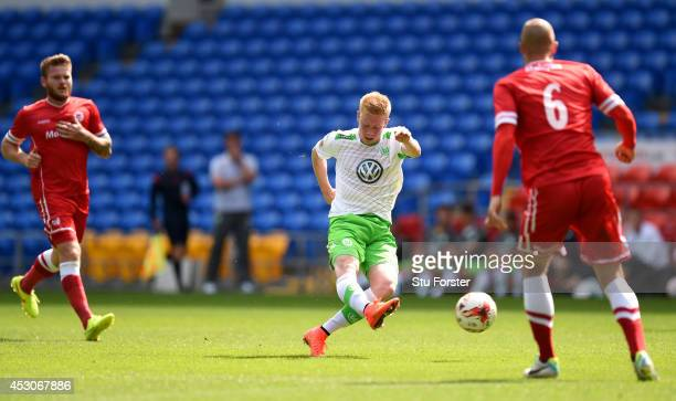 Wolfburg forward Kevin De Bruyne shoots to score the 2nd Wolfsburg goal during the friendly match between Cardiff City and VFL Wolfsburg at Cardiff...