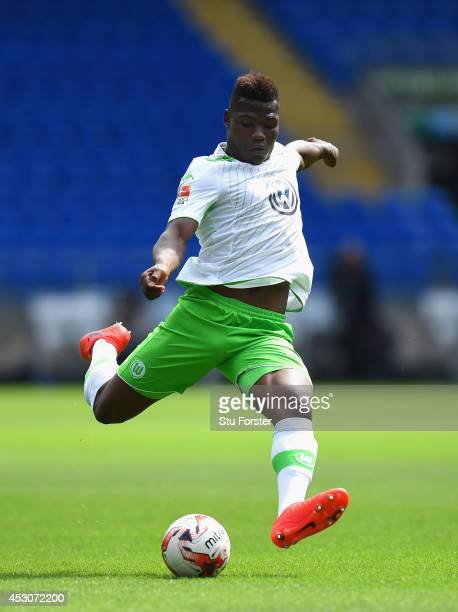 Wolfburg player Junior Malanda in action during the friendly match between Cardiff City and VFL Wolfsburg at Cardiff City Stadium on August 2 2014 in...