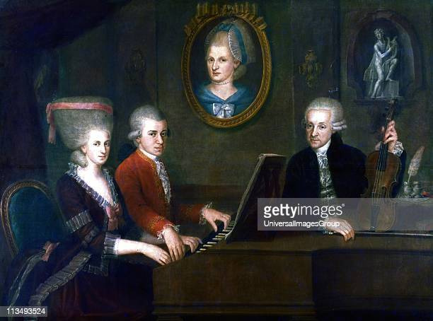 Wolfgang Amadeus Mozart with his sister Maria Anna and father Leopold in frot of a portrait of the children's mother Anna Maria Painted by Johann...