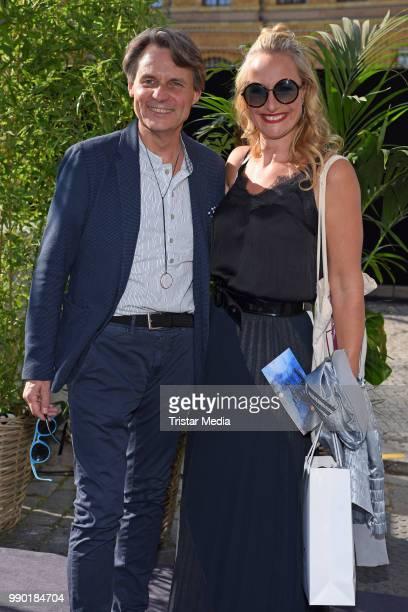 Wolfgang Bahro and Eva Mona Rodekirchen attend the Guido Maria Kretschmer show during the Berlin Fashion Week Spring/Summer 2019 at ewerk on July 2...