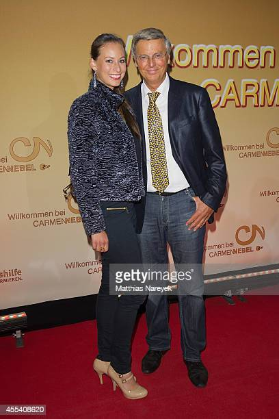 Wolfgang Bosbach and Caroline Bosbach attends the 'Willkommen bei Carmen Nebel' show at Velodrom on September 13 2014 in Berlin Germany