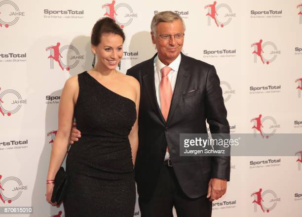 Wolfgang Bosbach and his daughter pose at the 10th anniversary celebration of the Sports Total Agency on November 5 2017 in Cologne Germany