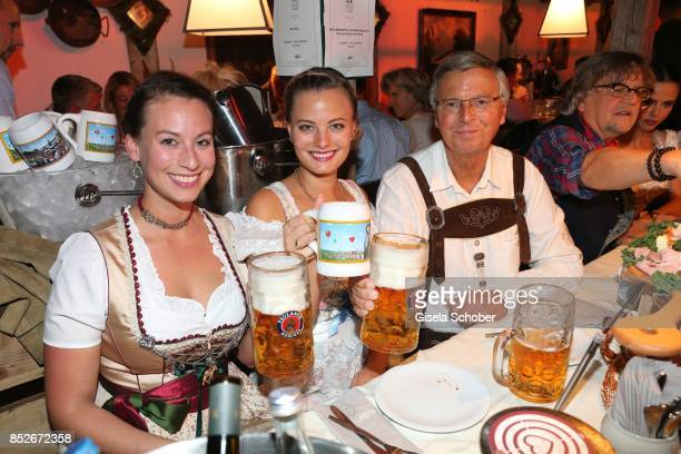 Wolfgang Bosbach with his daughters Caroline and Viktoria during the Oktoberfest at Theresienwiese on September 23 2017 in Munich Germany
