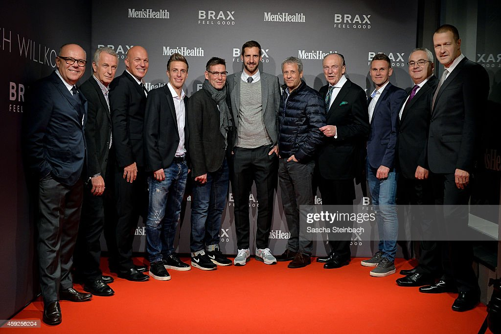 Wolfgang Drewalowski, managing director of Brax Leineweber, Rainer Bonhof, vice president of Borussia Moenchengladbach, Lars Bultink, managing director of Brax Store, Patrick Herrmann, goalkeeper coach Uwe Kamps, goalkeeper Christopher Heimeroth, head coach Lucien Favre, president Rolf Koenigs and Filip Daems of Borussia Moenchengladbach, Stefan Brandmann, managing director of Brax Leineweber and Joachim Beer, managing director of Brax Leineweber,attend the BRAX store opening on November 19, 2014 in Moenchengladbach, Germany.