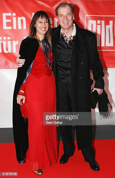 Wolfgang Fierek and his wife Djamila arrive at the 'Ein Herz Fuer Kinder' Gala on December 18 2004 at The Axel Springer building in Berlin Germany