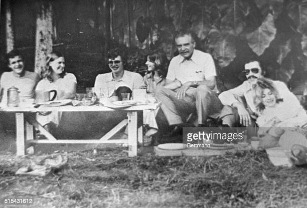 Wolfgang Gerhard, allegedly Josef Mengele, is shown seated with friends in an album photograph taken at an undisclosed date during the 1970s.