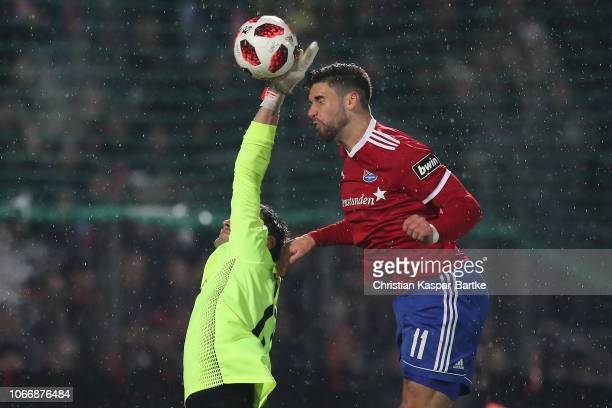 Wolfgang Hesl of Kaiserslautern challenges Stefan Schimmer of SpVgg Unterhaching during the 3 Liga match between SpVgg Unterhaching and 1 FC...