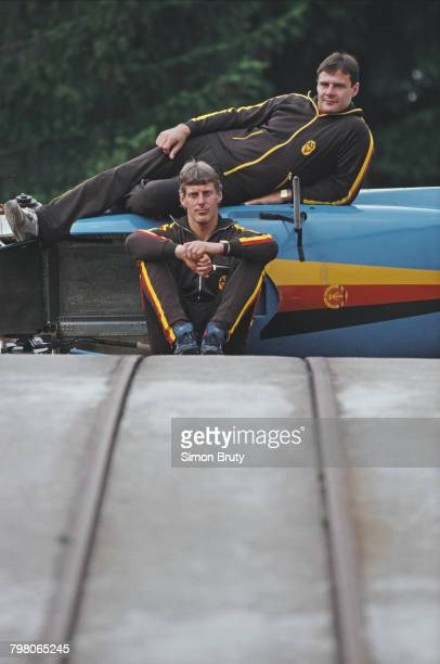 Wolfgang Hoppe and Dietmar Schauerhammer of East Germany pose for a team picture with their two man sled during training on 1 August 1987 at the...