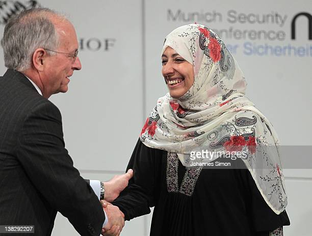Wolfgang Ischinger chairman of the 48th Munich security conference welcomes Tawakkul Karman Nobel peace laureate 2011 during day 3 of the 48th Munich...