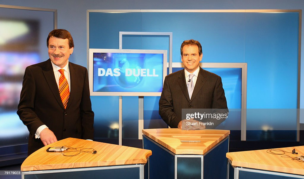 Wolfgang Juettner (L) candidate of the Social Democratic Party (SPD) and Andreas Cichowicz (C), chief editor of the tv channel NDR attend a television debate with challenger Christian Wulff, candidate of the Christian Democratic Union (CDU) and Governor of Lower Saxony at the NDR television studios on January 23, 2008 in Hanover, Germany. Lower Saxony faces state elections on January 27, 2008.