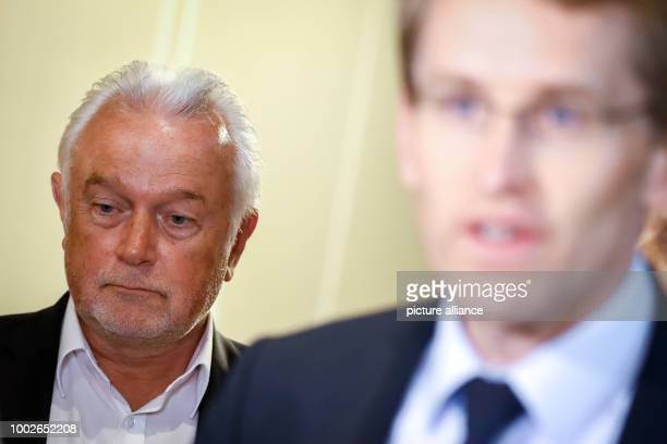Wolfgang Kubicki parliamentary chairman of Germany's Free Democratic Party in SchleswigHolstein listens to the statement of Daniel Günther state...