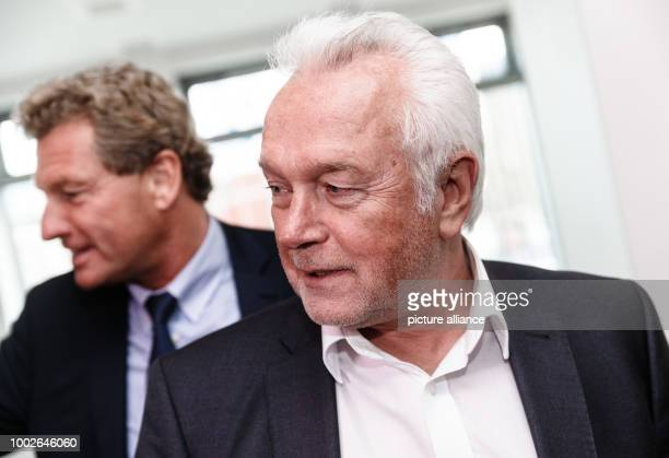 Wolfgang Kubicki parliamentary leader of the Free Democratic Party at the SchleswigHolstein state parliament talks to journalists next to Bernd...