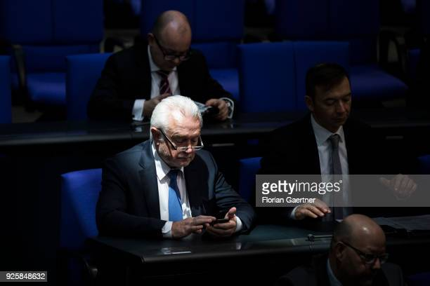 Wolfgang Kubicki VicePresident of the Bundestag works with his smartphone during a plenary session at the German Bundestag on February 28 2018 in...