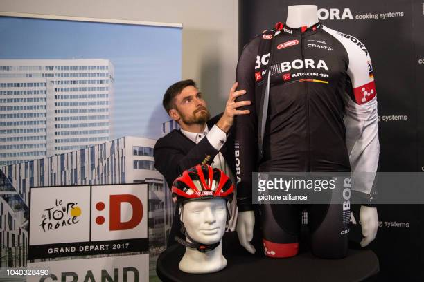 Wolfgang Lagler Marketing manager of Craft Sportswear presents the team jersey at an introductory press event for the Bora Argon 18 team for the Tour...