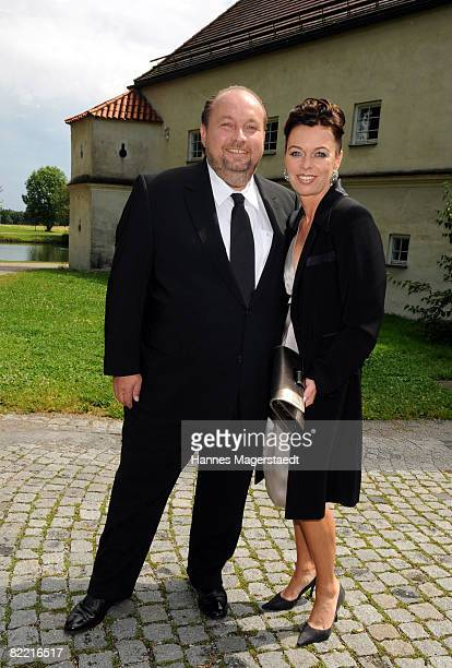 Wolfgang Lippert and Eva Binder attend the wedding of Designer Sarah Kern and Goran Munizaba at Blutenburg Castle on August 8 2008 in Munich Germany...
