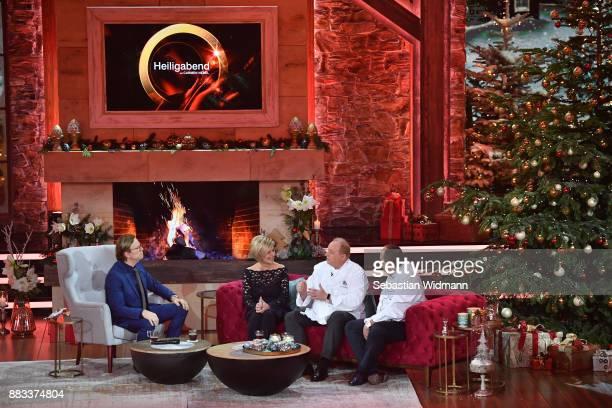 Wolfgang Lippert Carmen Nebel Alfons Schuhbeck and Johann Lafer talk during the tv show 'Heiligabend mit Carmen Nebel' on November 29 2017 in Munich...