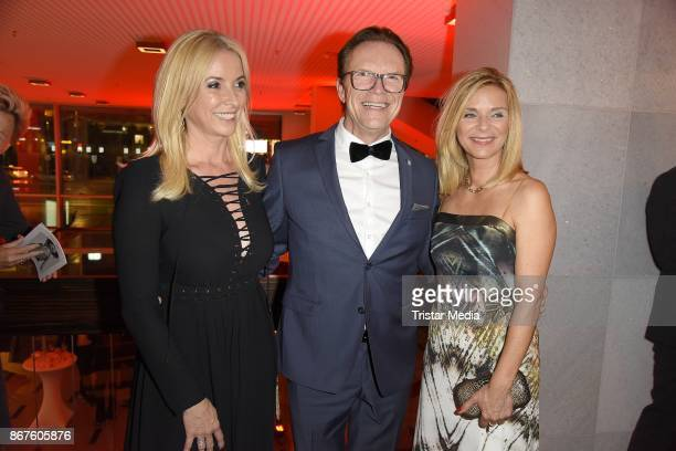 Wolfgang Lippert his wife Gesine Lippert and Uta Bresan attend the 12th Hope Charity Gala at Kulturpalast on October 28 2017 in Dresden Germany