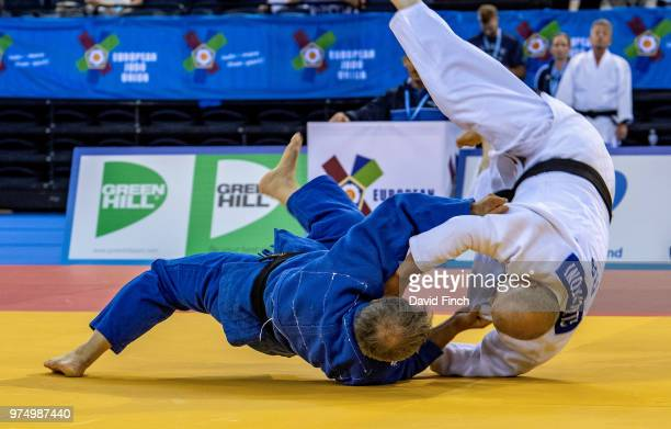 Wolfgang Loeffler of Germany throws Giovanni Lucantoni of Italy with a stomach throw for ippon to win their u73kg M8 contest on his way to the gold...