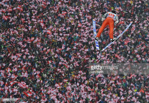 Wolfgang Loitzl of Austria competes during the first round for the FIS Ski Jumping World Cup event of the 61st Four Hills ski jumping tournament at...
