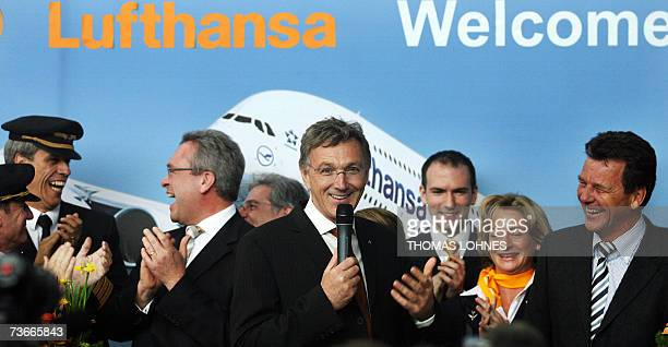 Wolfgang Mayrhuber chairman of German airline Lufthansa and crew members of the Airbus A380 stand in front of a picture of the super jumbo 22 March...
