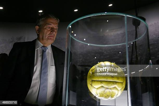 Wolfgang Niersbach DFB president watches the football of the 1954 final World Cup match during the Media Day of the German Football Museum at German...