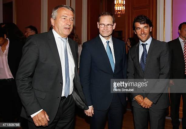Wolfgang Niersbach president of German Football Association and UEFA Committee member poses with Michael Mueller mayor of Berlin and KarlHeinz Riedle...