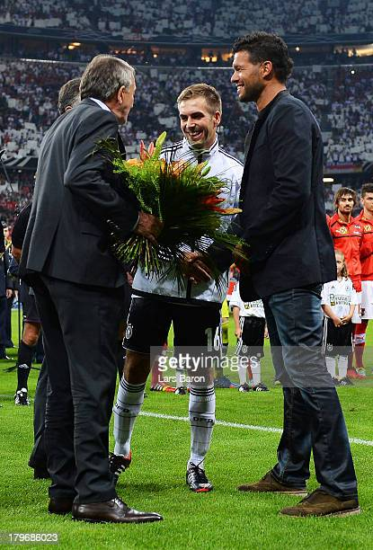 Wolfgang Niersbach president of German Football Association DFB shakes hands with Philipp Lahm of Germany and Michael Ballack during the FIFA 2014...