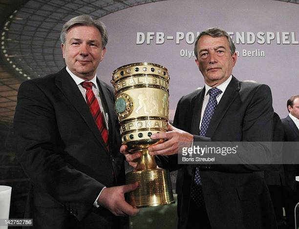 Wolfgang Niersbach , president of the German Football Association hands over the cup to Klaus Wowereit, mayor of Berlin during the DFB cup handover...