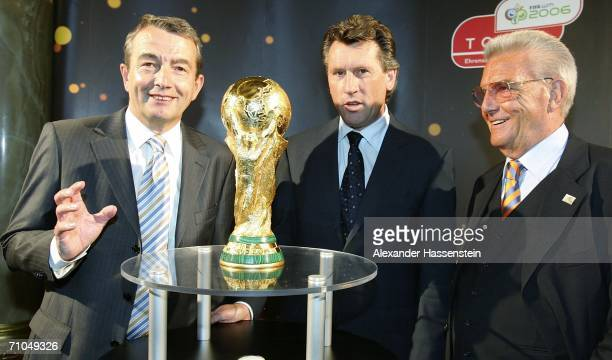 Wolfgang Niersbach Vice President of the World Cup 2006 Organising Committee poses with former Soccer player Manfred Kaltz Friedel Guett President of...