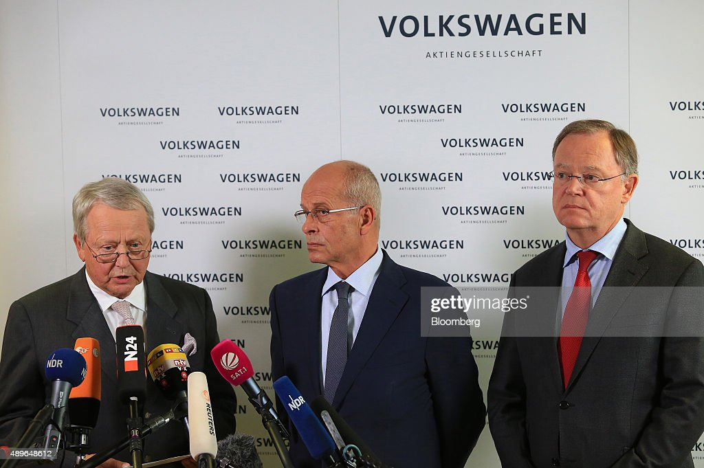 Wolfgang Porsche, chairman of Porsche SE, left, speaks as the resignation of VW Chief Executive Officer Martin Winterkorn is announced while Berthold Huber, interim chairman of Volkswagen AG (VW), center, and Stephan Weil, prime minister of the German state of Lower Saxony, look on at the automobile manufacturer's headquarters in Wolfsburg, Germany, on Wednesday, Sept. 23, 2015. Winterkorn, who during nearly a decade at the helm catapulted VW to the top spot in global sales, stepped down after admitting the automaker cheated on U.S. emissions tests. Photographer: Krisztian Bocsi/Bloomberg via Getty Images