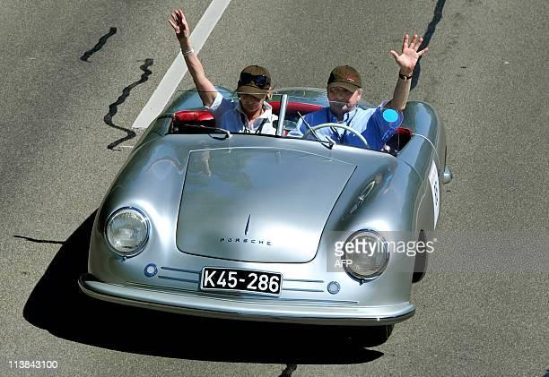 Wolfgang Porsche grandson of Porsche founder Ferdinand Porsche drives a Porsche 356 No1 the first car ever built by Porsche during a rally to...