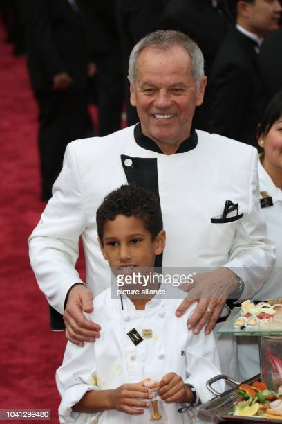 Wolfgang Puck and his son Oliver attend the 86th Academy Awards aka Oscars at Dolby Theatre in Los Angeles USA on 02 March 2014 Photo Hubert Boesl |...