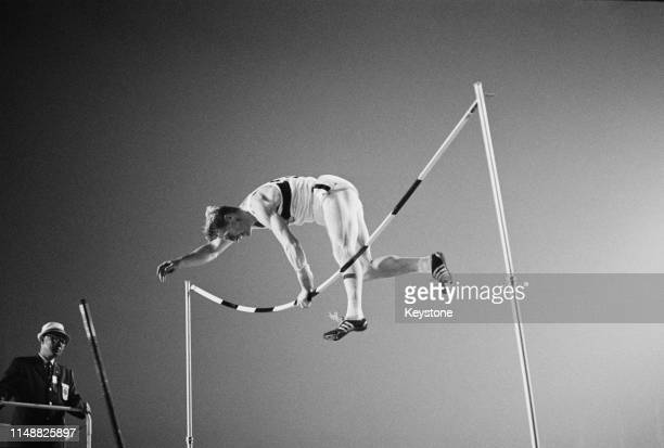 Wolfgang Reinhardt of the United Team of Germany bends the height cross bar in the Men's pole vault competition on 17th October 1964 during the XVIII...