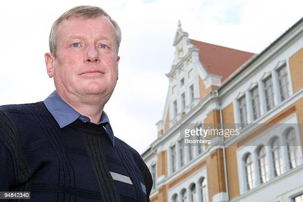 Wolfgang Renner a math and physics teacher at the Clara Zetkin Middle School poses in front of the school in Freiberg Germany on Thursday Sept 25...