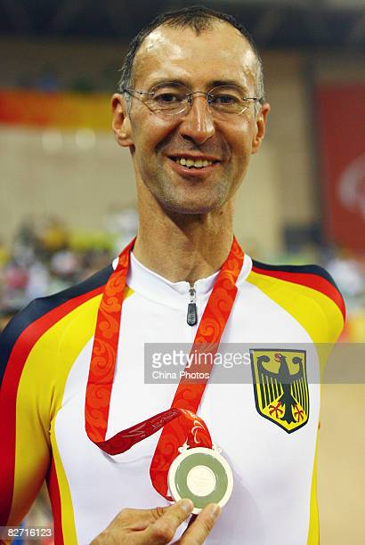 Wolfgang Sacher of Germany displays his silver medal of the Men's Individual Pursuit during the Track Cycling event at the Laoshan Velodrome during...