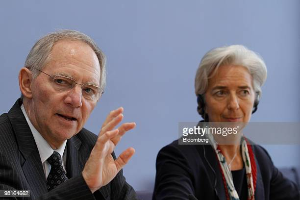 Wolfgang Schaeuble, Germany's finance minister, left, speaks as Christine Lagarde, France's finance minister, listens after a meeting of the German...