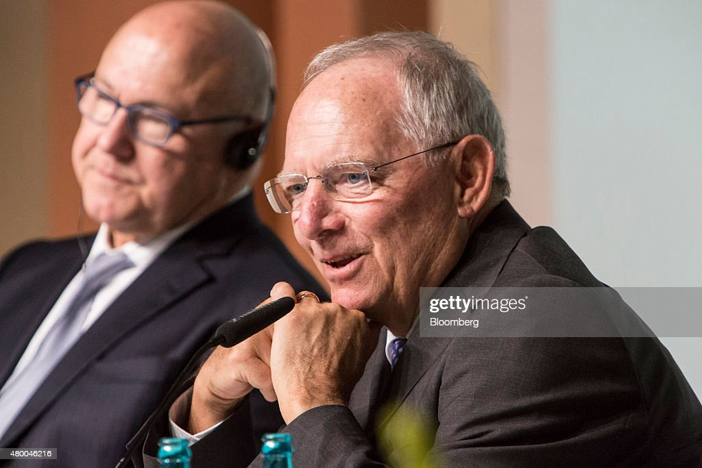 Wolfgang Schaeuble, Germany's finance minister, right, speaks as he sits beside Michel Sapin, France's finance minister, during a Deutsche Bundesbank conference in Frankfurt, Germany, on Thursday, July 9, 2015. Schaeuble says he told Greece 'just do it' with regard to outlining latest aid proposals. Photographer: Martin Leissl/Bloomberg via Getty Images