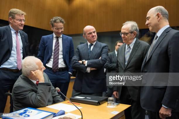 Wolfgang Schaeuble Germany's finance minister second left speak with from left Johan Van Overtveldt Belgium's finance minister Jeroen Dijsselbloem...