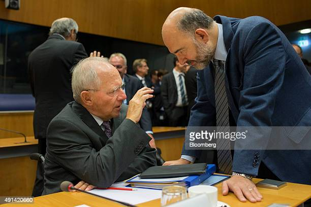 Wolfgang Schauble Germany's finance minister left speaks with Pierre Moscovici economic commissioner for the European Union ahead of roundtable talks...