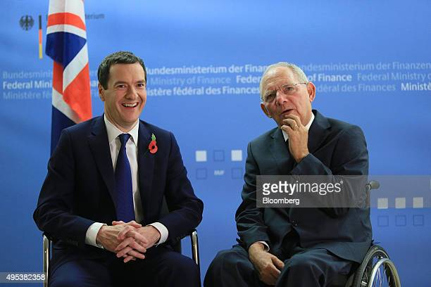 Wolfgang Schauble Germany's finance minister right speaks with George Osborne UK chancellor of the exchequer at the ministry of finance in Berlin...
