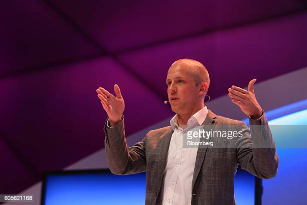 Wolfgang Stezle chief executive officer of Re'flekt GmbH gestures whilst speaking during a Hyperloop transportation system augmented reality window...