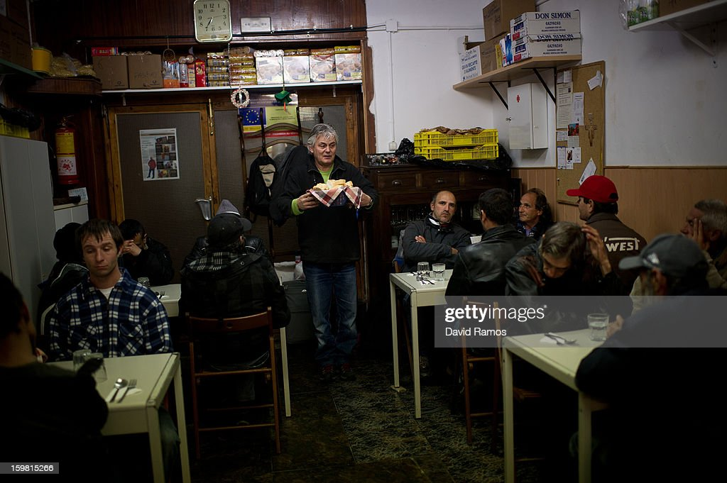 Wolfgang Striebinger of Germany, 60, says grace before serving the dinner to needy people at 'El Chiringuito de Dios' ('The Stall of God') on January 4, 2013 in Barcelona, Spain. The German pastor Wolfgang Striebinger has lived in Barcelona since 1991, originally employed to minister to youths during the Barcelona Olympic Games, he decided to stay and since 2000 has run 'El Chinguito de Dios' (The Stall of God). In his mission to support the homeless, Wolfgang and his volunteers offer a place for up to 200 people to come and have some food daily and also offering them assistance with grooming and clothes. Many of the volunteers are homeless and help out in return for meals and a bed. Wolfgang's ethos is to provide peace, calm and dignity to all those that need it amongst Barcelona's burgeoning homeless population. Due to the economic situation his doors are now also open to the long term unemployed and families with little or no income. According to the latest figures 21.8% of the Spanish populations are living below the poverty line.