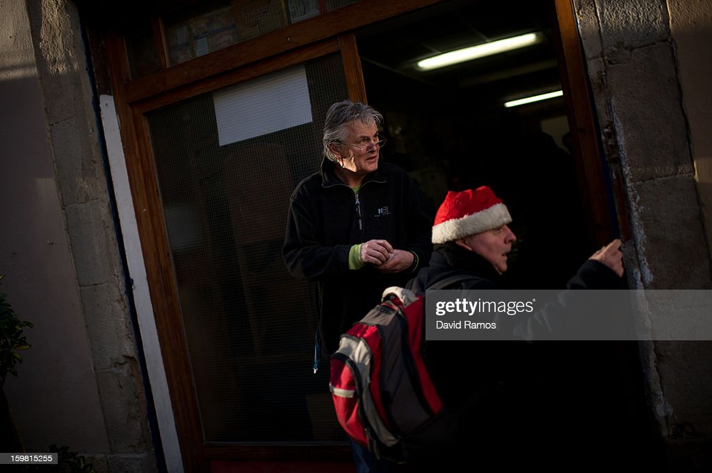 Wolfgang Striebinger of Germany, 60, welcomes needy people coming for breakfast at 'El Chiringuito de Dios' ('The Stall of God') on January 4, 2013 in Barcelona, Spain. The German pastor Wolfgang Striebinger has lived in Barcelona since 1991, originally employed to minister to youths during the Barcelona Olympic Games, he decided to stay and since 2000 has run 'El Chinguito de Dios' (The Stall of God). In his mission to support the homeless, Wolfgang and his volunteers offer a place for up to 200 people to come and have some food daily and also offering them assistance with grooming and clothes. Many of the volunteers are homeless and help out in return for meals and a bed. Wolfgang's ethos is to provide peace, calm and dignity to all those that need it amongst Barcelona's burgeoning homeless population. Due to the economic situation his doors are now also open to the long term unemployed and families with little or no income. According to the latest figures 21.8% of the Spanish populations are living below the poverty line.